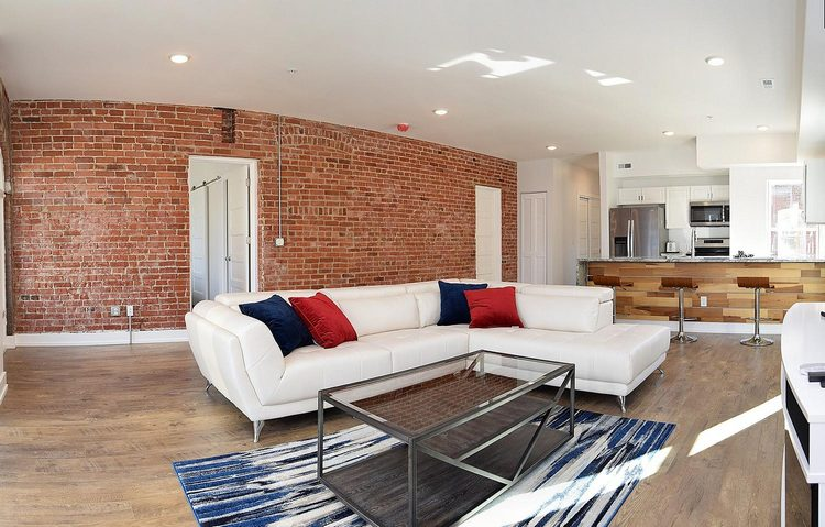 Indianapolis Property Penn Building family room brick wall